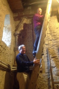Bishop checks on the bell chamber restoration